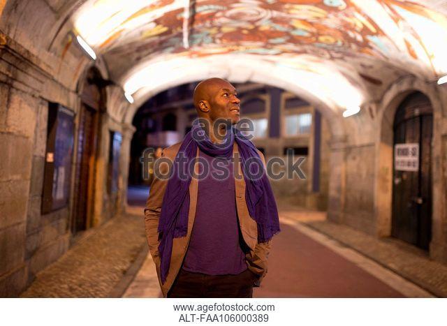 Traveler admiring graffiti on ceiling