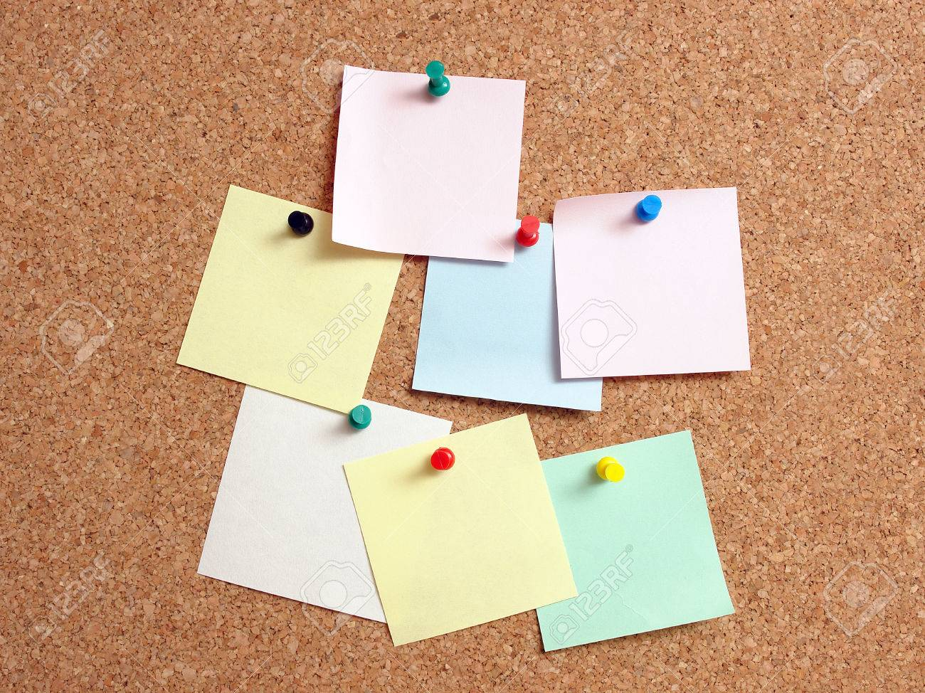 Colorful blank paper notes affixed to the corkboard Stock Photo - 28645529