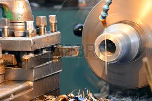 Machining on a lathe, processing of metal by cutting.