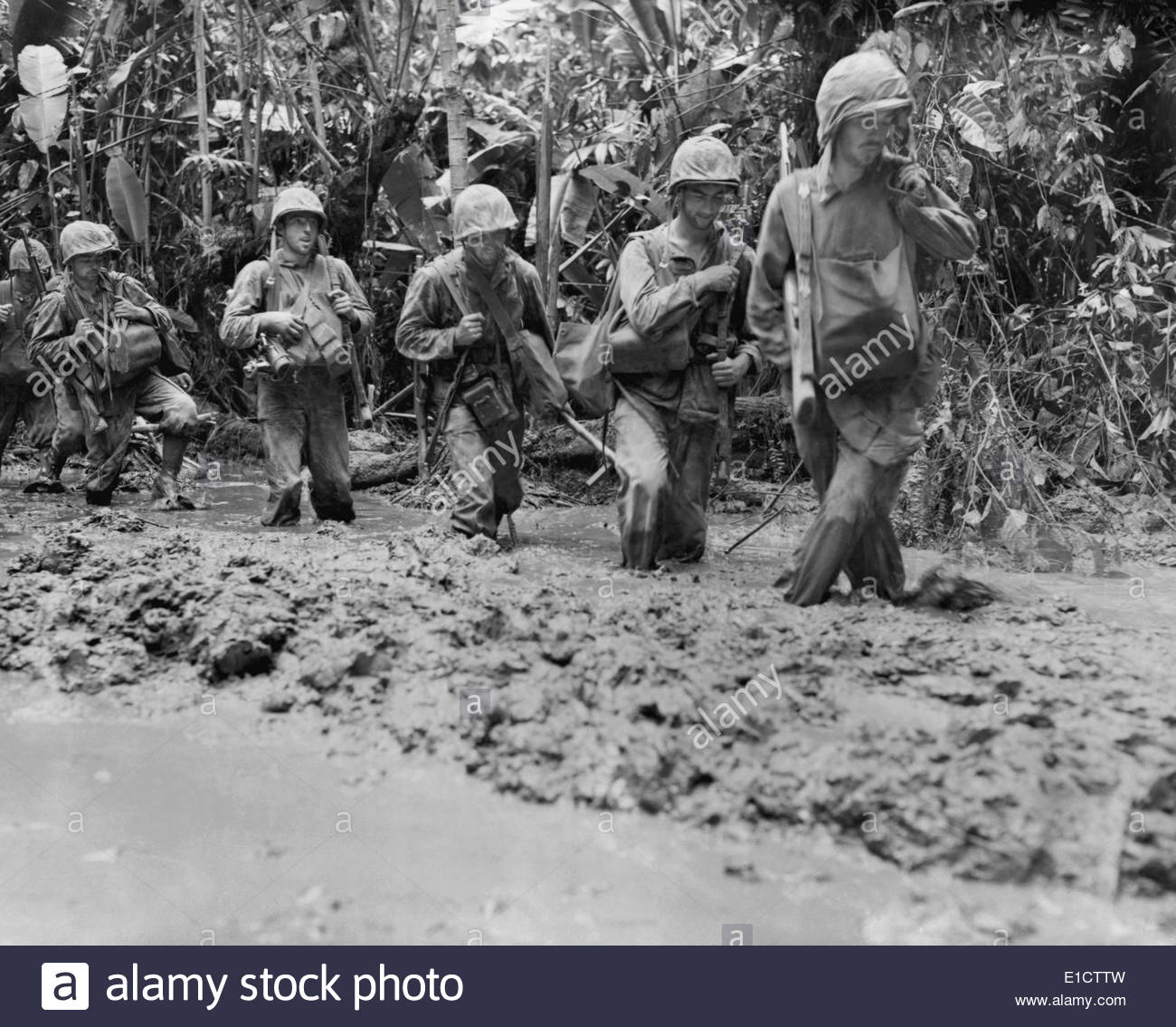 U.S. Marines run afoul of General Mud on Bougainville Island during World  War 2. The leader (right) is recovering his balance