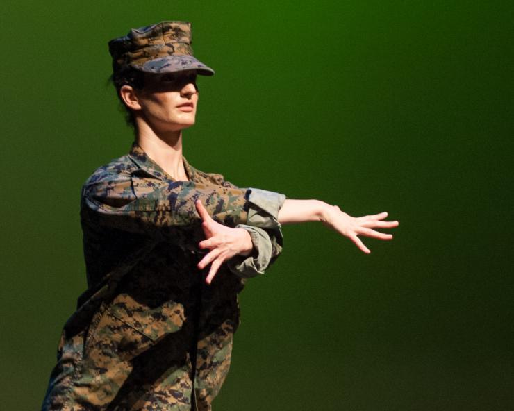 dancer in army uniform Aggressed