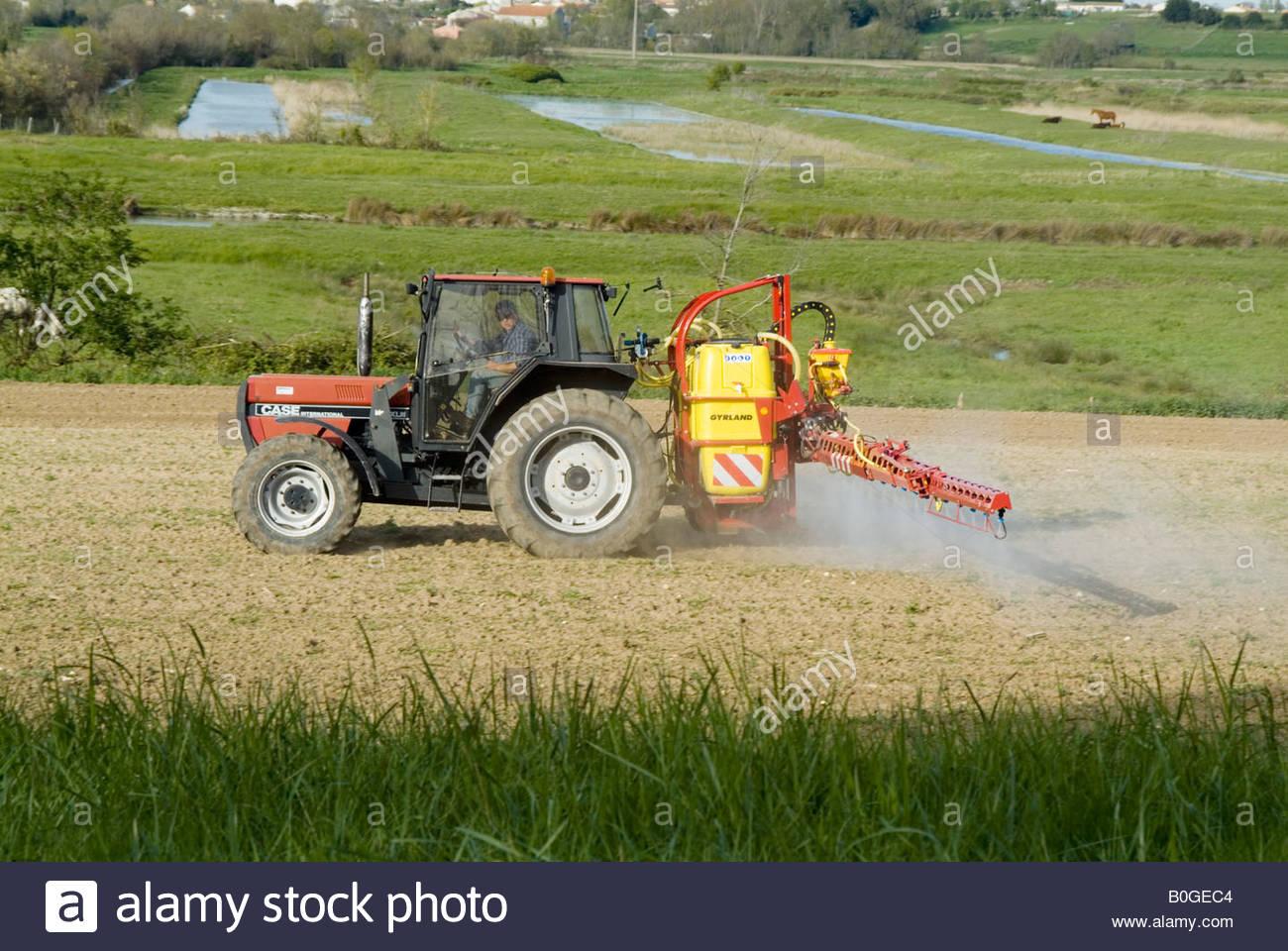 tractor spraying pesticide fertilizer tank sprayer crop agri chemical  agrichemical agriculture farm farming farmer defra maff