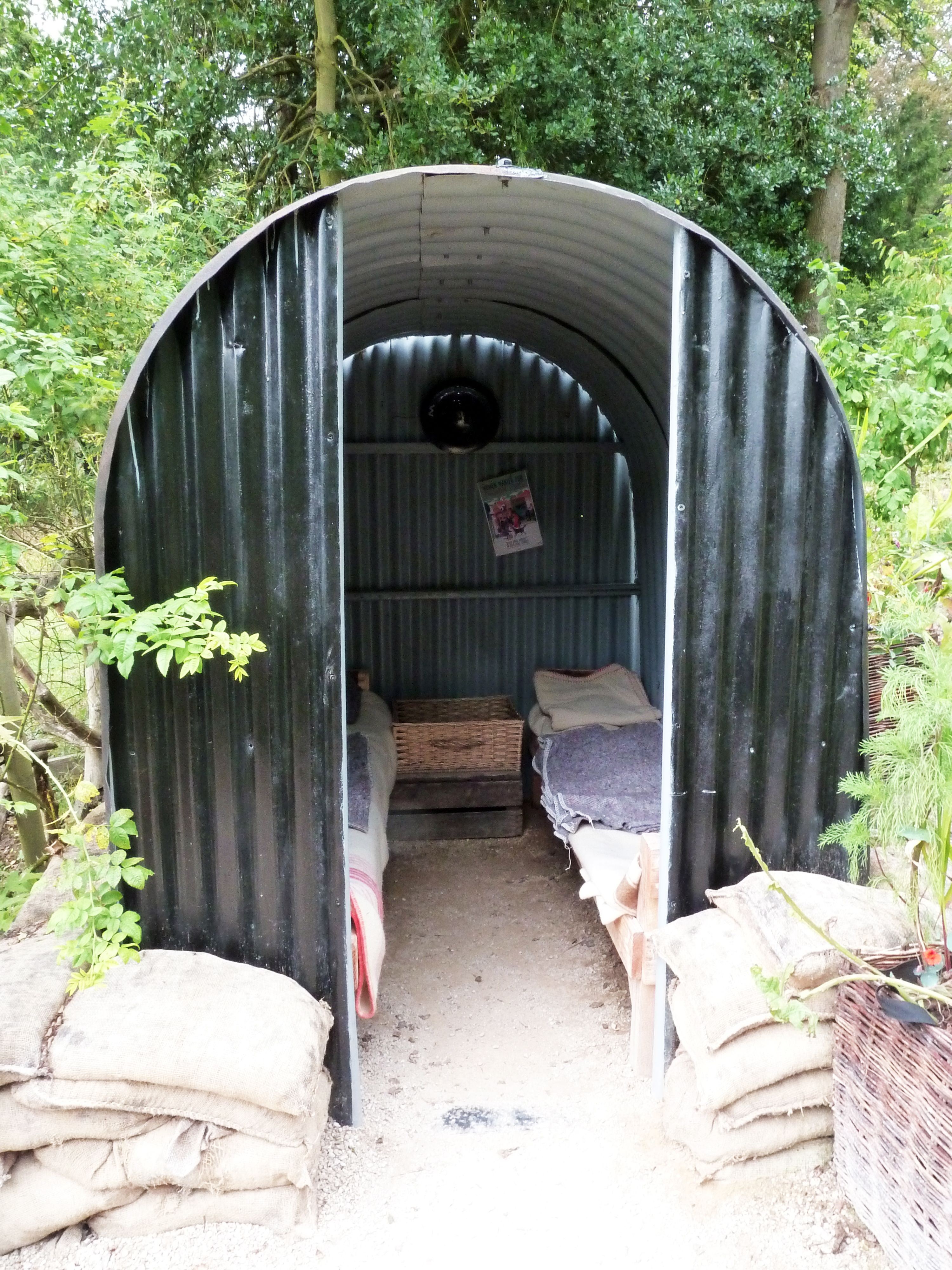 Anderson shelter in Chatsworth Castle Park, UK. Air-raid shelter made in  WWII in UK. 6 people can live in it. The structure is made to deform.