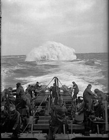 Depth charges detonate astern of the sloop HMS Starling. She participated in  the sinking of 14 U-boats throughout the war
