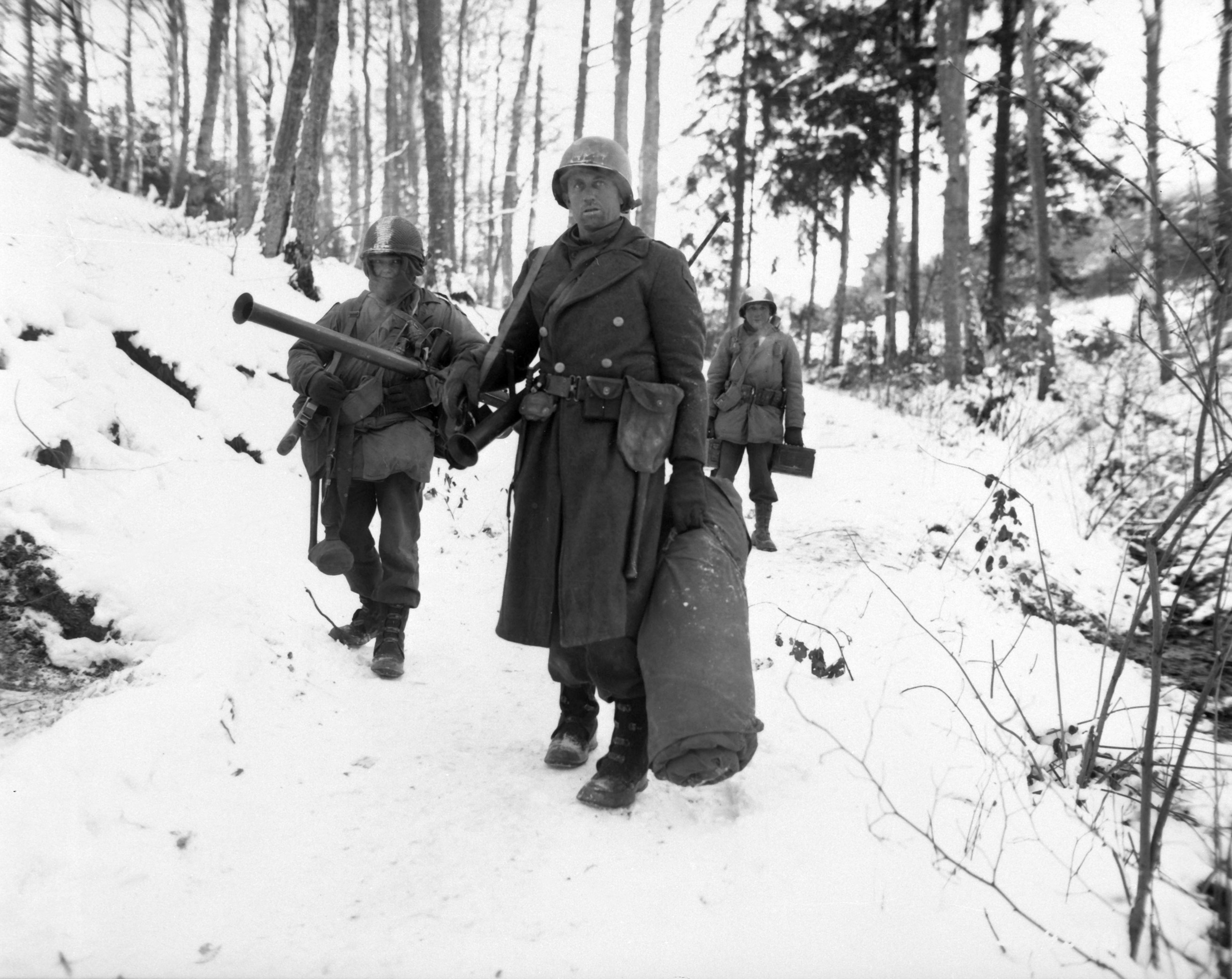 American engineers emerge from the woods and move out of defensive  positions after fighting in the