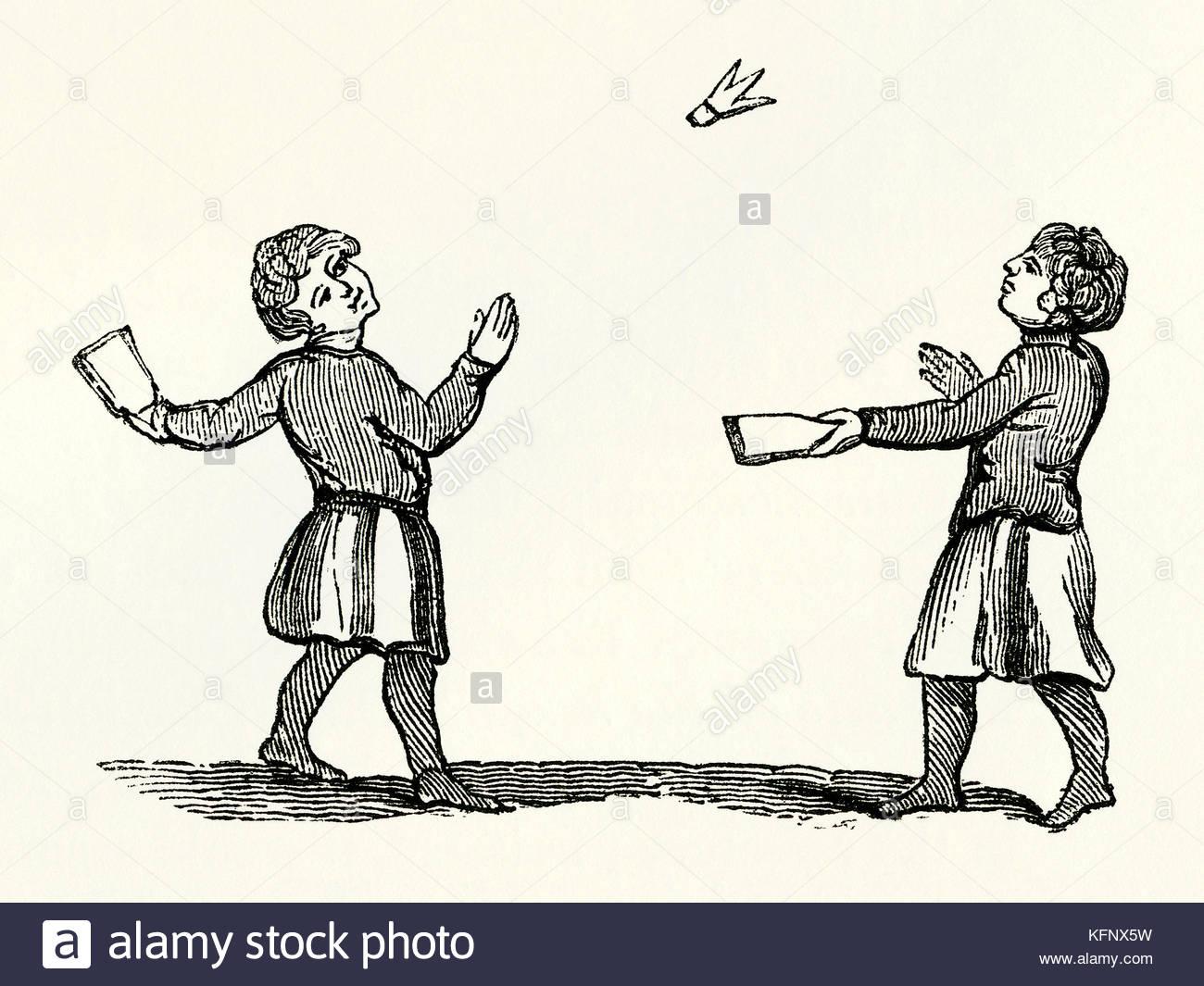 Un viejo grabado medieval de battledore y shuttlecock o jeu de volant, un  juego de principios relacionados con el bádminton moderno