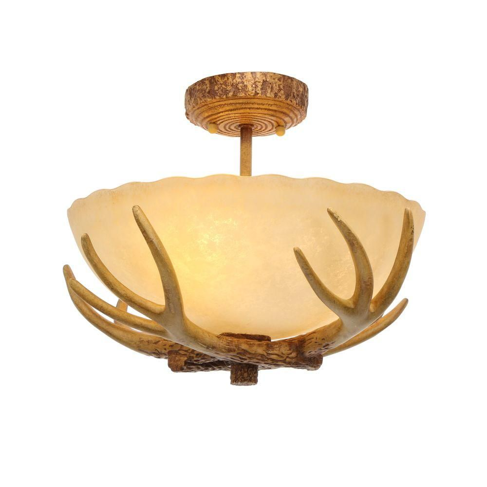 Impart rustic charm to your decor with the Hampton Bay Antler Ceiling  Light.The authentic-looking antler horns are set against an amber sunset  glass shade.