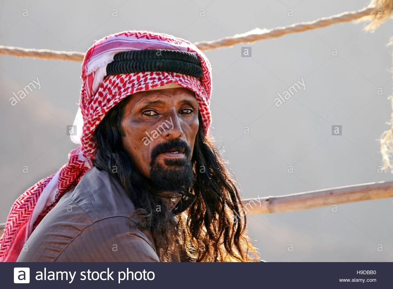 an old jordan beduin catched during a tea break, Petra - Stock Image