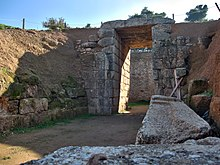 The Lion Tholos Tomb at Mycenae. Of note are the ashlar stomion (of  conglomerate) and dromos while the chamber itself remains made of smaller  stones,