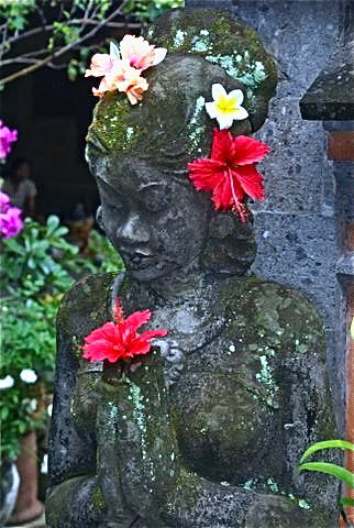 Beflowered statue of Goddess in Bali