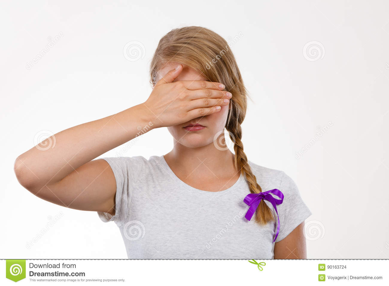 Anxiety, bullying at school concept. Shy teenage girl covering her face  with hands.