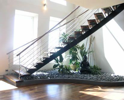 Love the use of having a zen rock garden below stairs
