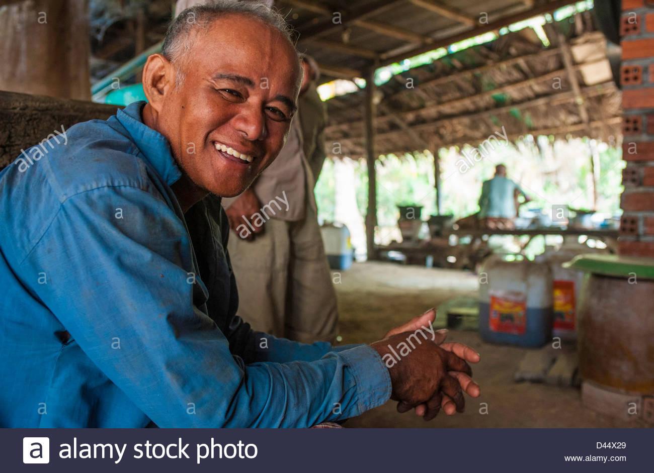 Sdey Village, Prek Phnom commune Srong Srean – Husband, bemedalled war  hero, delivery man, 52 in blue