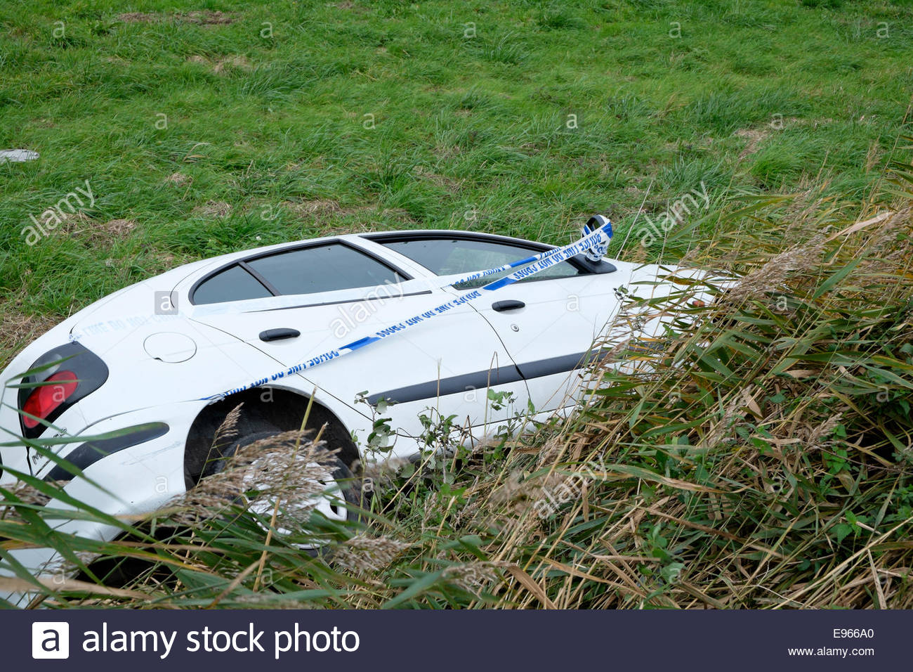 Car careered off road and slid down grassy bank the car has police aware  tape attached to it