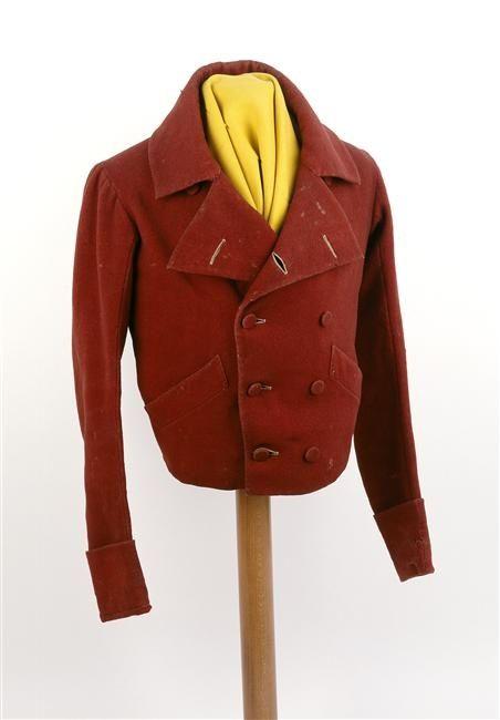 A carmagnole was a short woolen or cloth jacket of dark color worn by  laborers