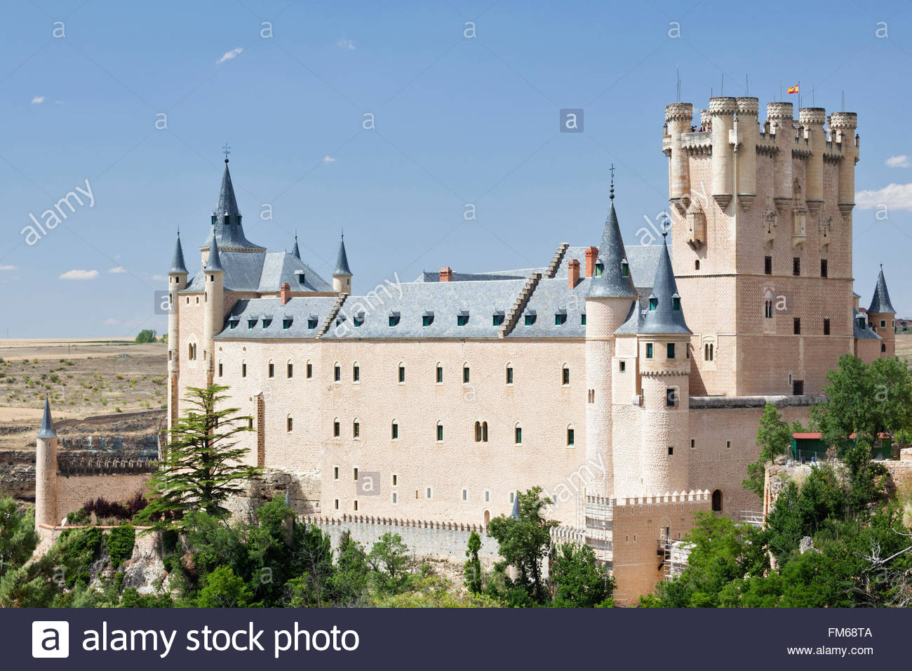 An exterior view of a large castle like building called Alcazar of Segovia,  seen from