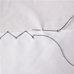 The blind catch stitch is worked in the same way, only with the hem edge  folded back about 1/2″. The stitch catches the back side of the hem to the  back
