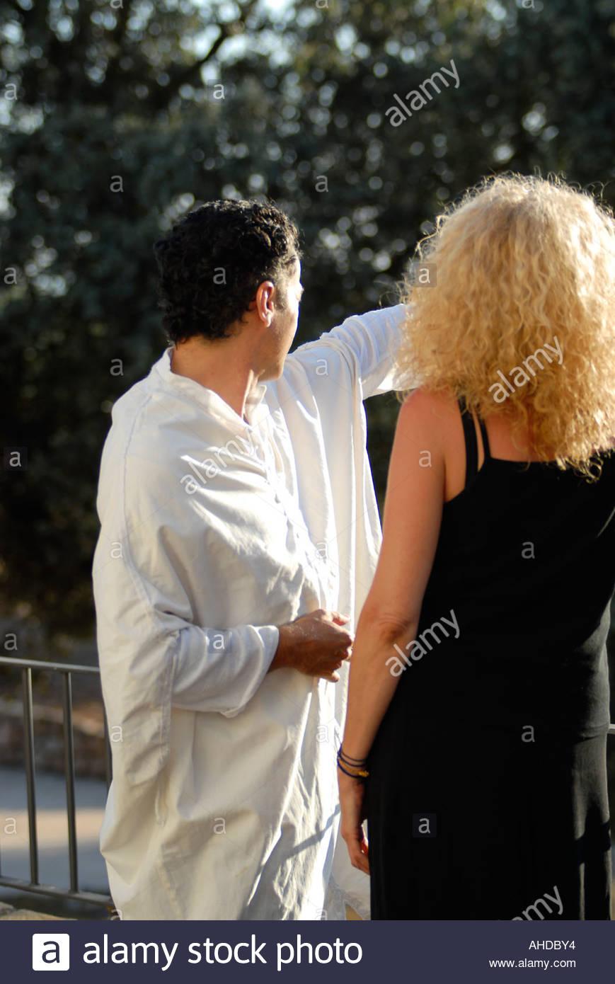Caucasic woman and arabian man.