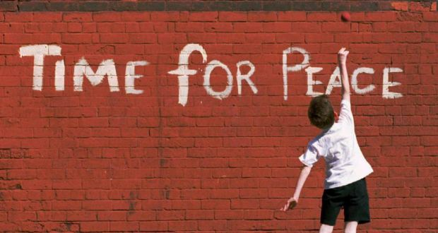 Sense of possibility: a child plays against a wall in north Belfast.  Photograph: