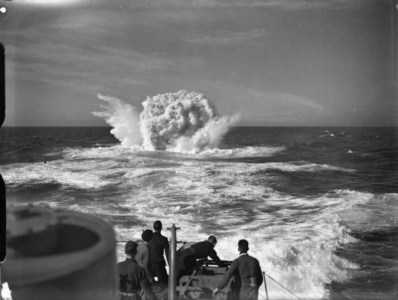 Depth charges exploding after being dropped by the destroyer HMS VANOC over  the spot indicated by