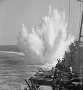 A depth charge explodes after being dropped from HMS Ceylon