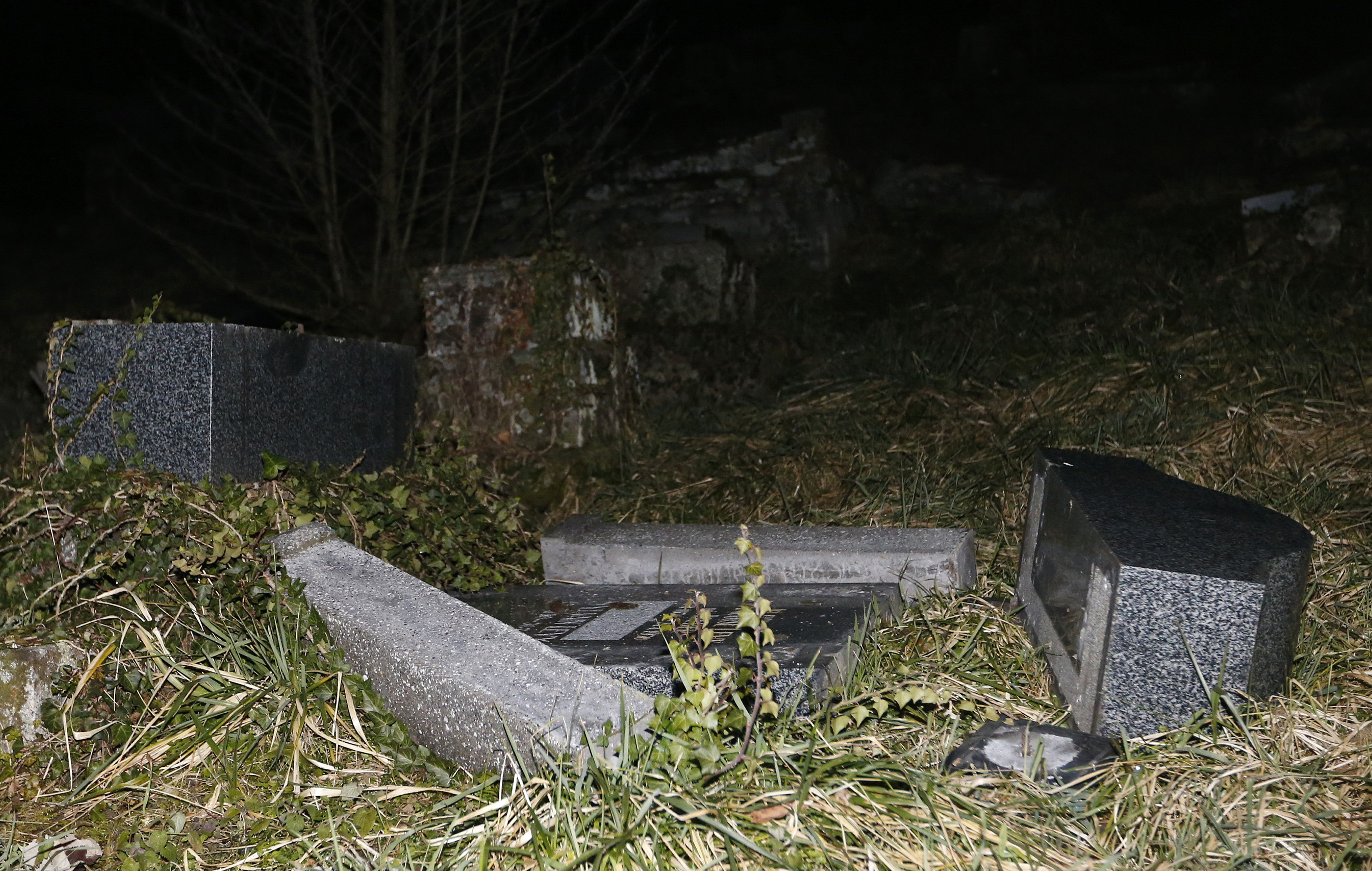 Desecrated tombstones are seen at Sarre-Union Jewish cemetery in eastern  France on Feb.
