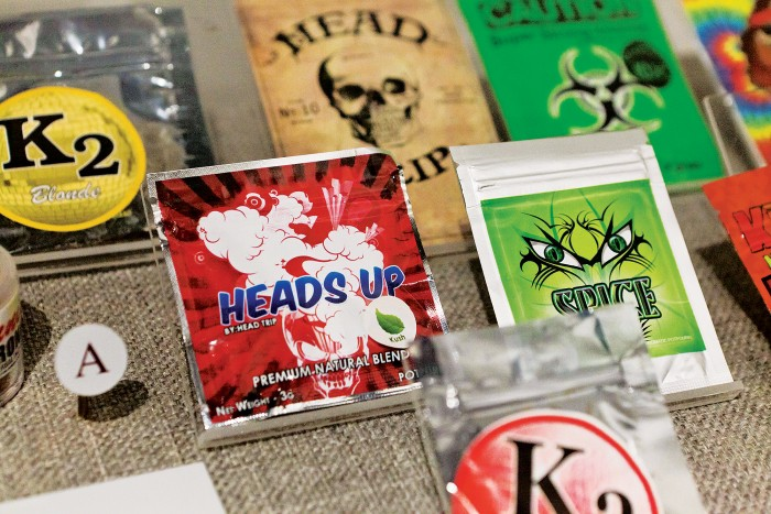 Photo of packets containing synthetic cannabinoids. Many synthetic designer  drugs