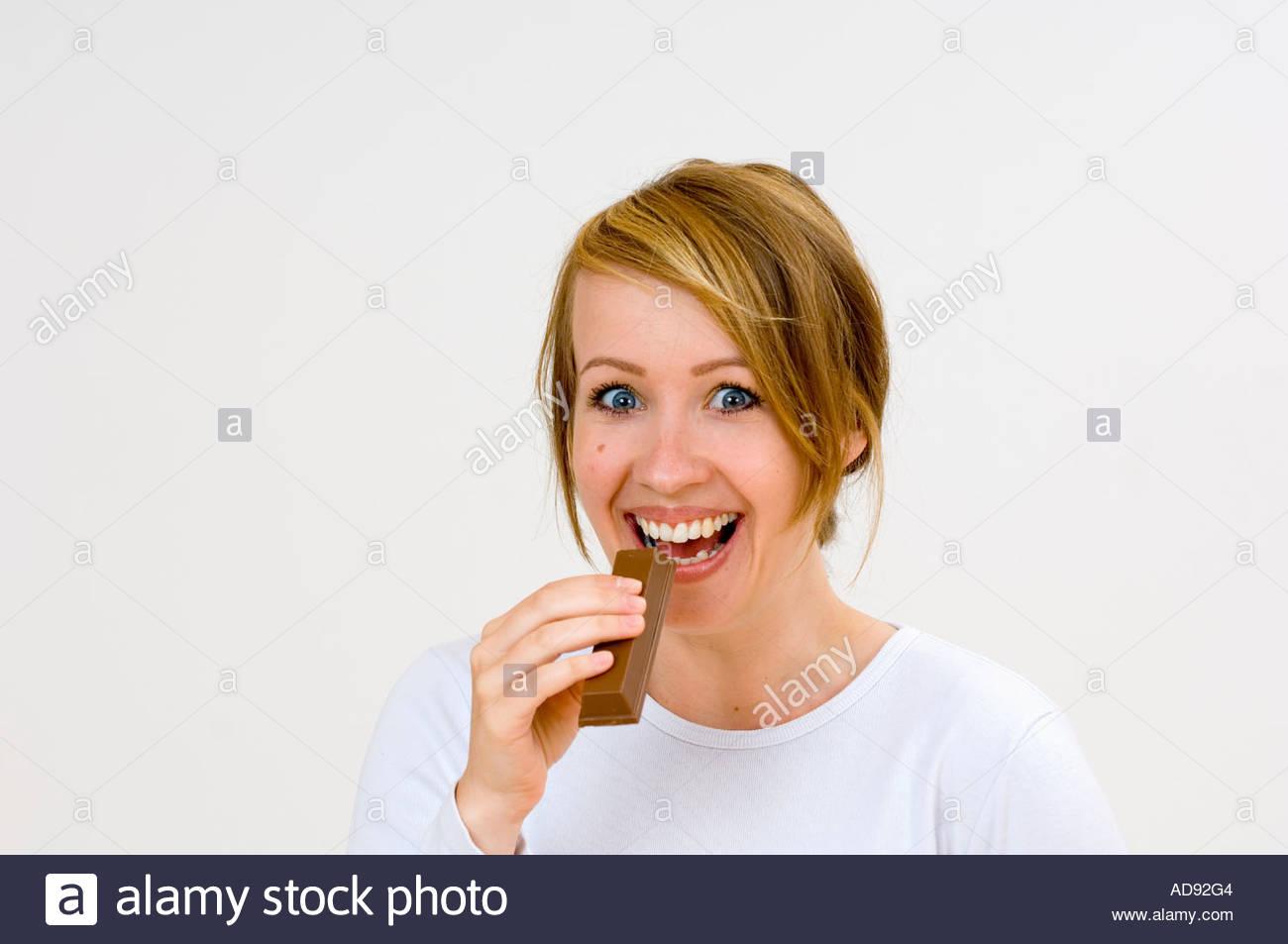 woman eating chocolate desirous