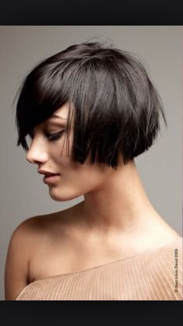 Ear-length Bob.. But maybe go a bit more straight across rather than  shorter in front