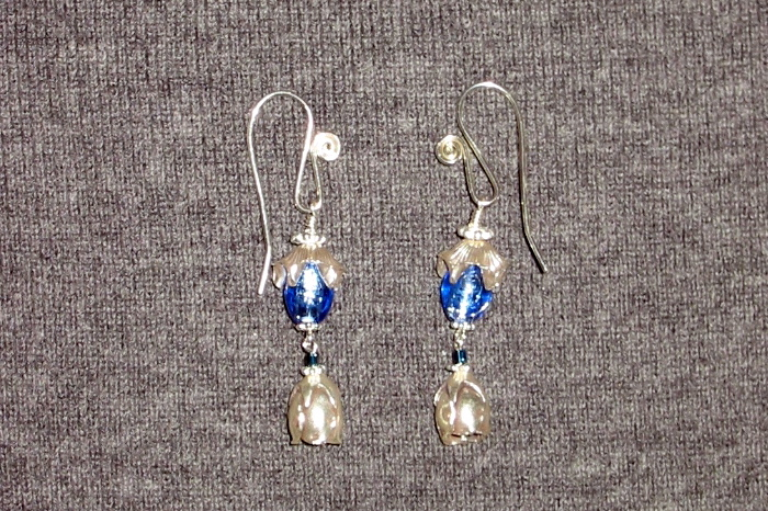 Another pair of ear bobs with smaller, lighter glass beads. The blue makes  me think of a drop of water or dew. You can see the ear wires here too.