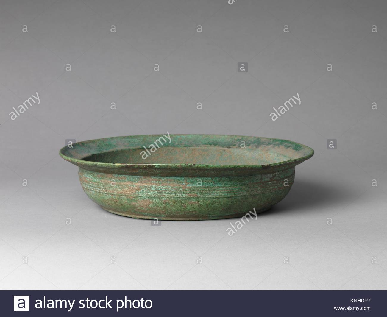 Period: Han dynasty (206 B.C.-A.D. 220) or earlier; Culture: China; Medium:  Bronze; Dimensions: H. 3 in. (7.6 cm); Diam. 13 1/2 in.