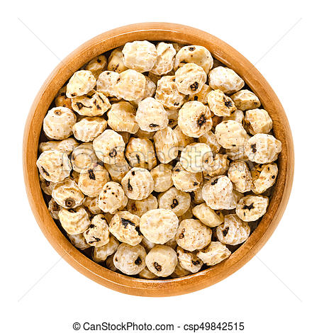 Tiger nuts, earth almonds, dried, in wooden bowl - csp49842515