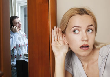 A woman eavesdropping on a phone conversation
