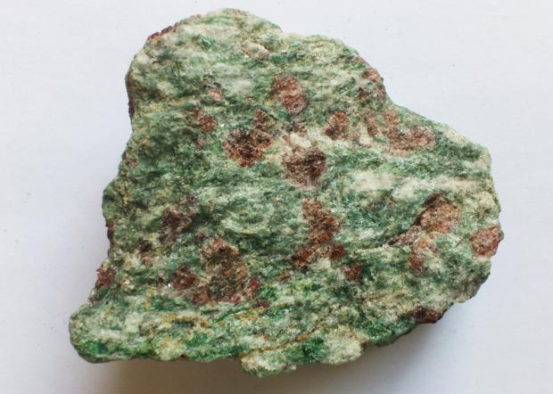 """""""Eclogite is one of the beautiful local rocks found among the gneisses of  Nordfjord,"""" says Ane Engvik at NGU. (Photo: Andreas R. Graven)"""