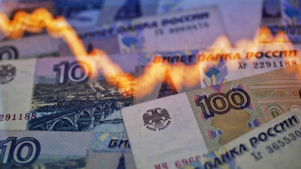A reflection of a yearly chart of U.S. dollars and Russian rubles is seen  on ruble notes. (Kacper Pempel/Reuters). For many policymakers, economic  sanctions