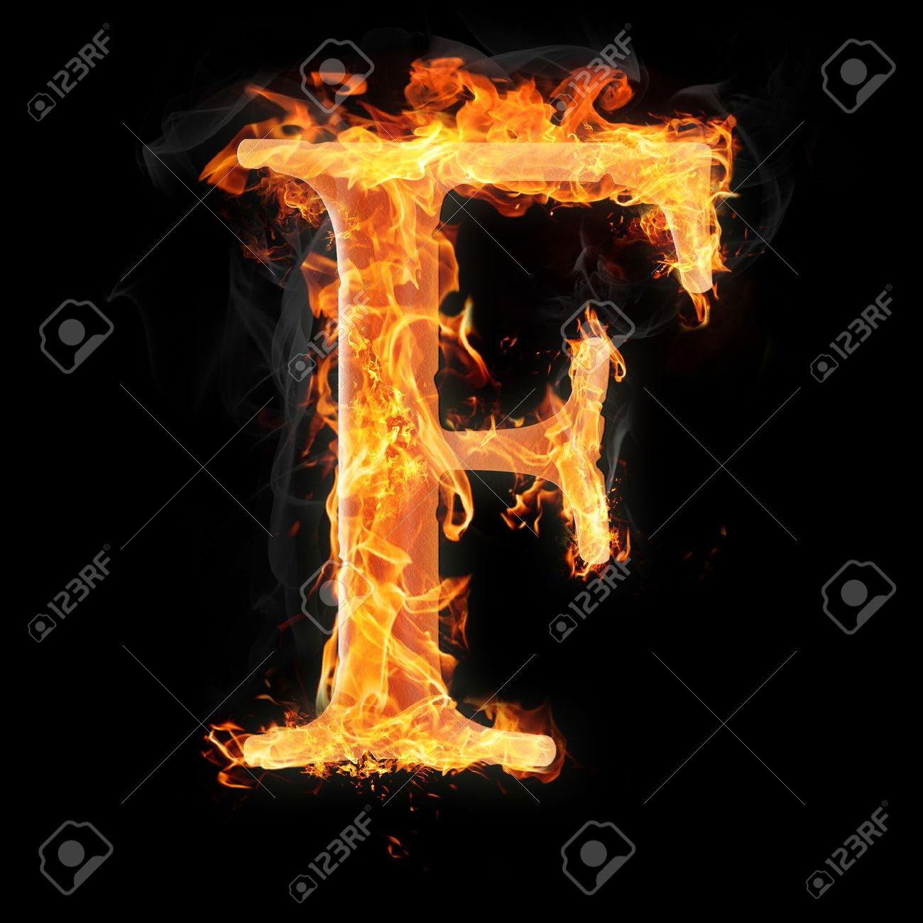 Foto de archivo - Las letras y los símbolos en el fuego - Letra F.