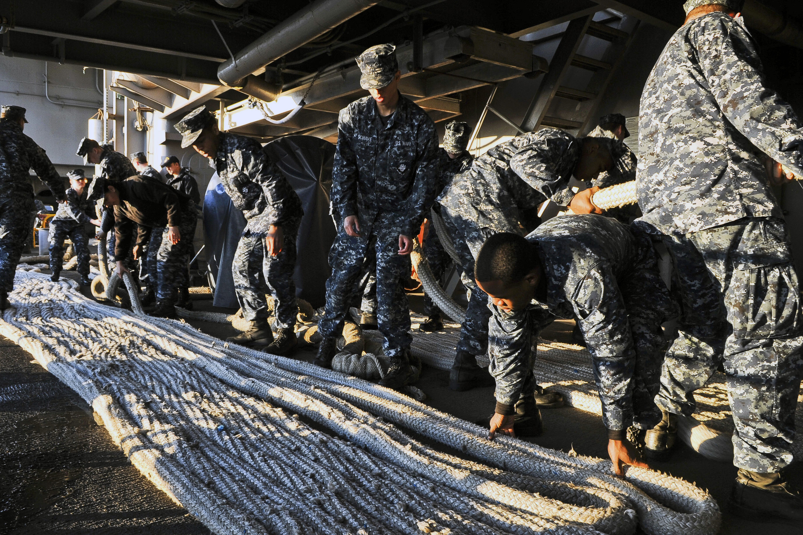 Sailors fake out a mooring line aboard the aircraft carrier USS George H.W.  Bush at Naval