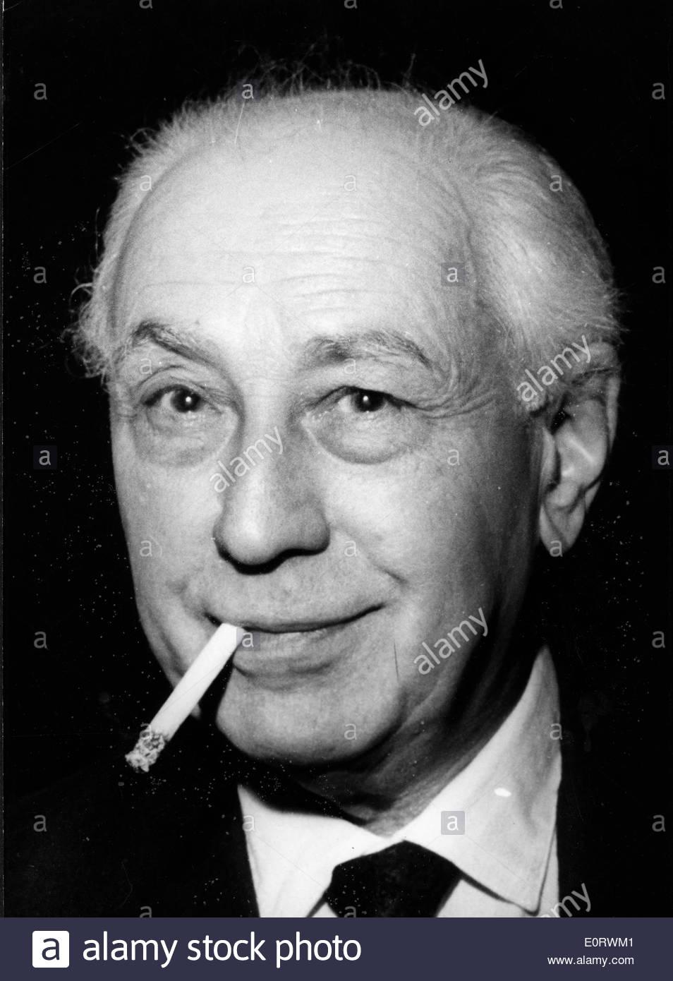 Director Abel Gance smokes a cigarette