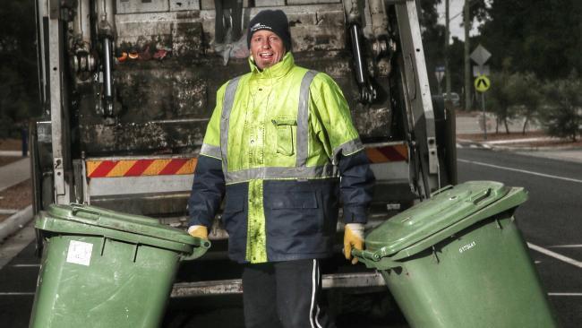 Ex-AFL champ John Barnes turns garbage man, loves it! http:/