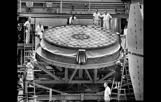 The 5 meter (16 ft. 8 in.) mirror in December 1945 at the Caltech Optical  Shop when grinding resumed following World War 2. The honeycomb support  structure