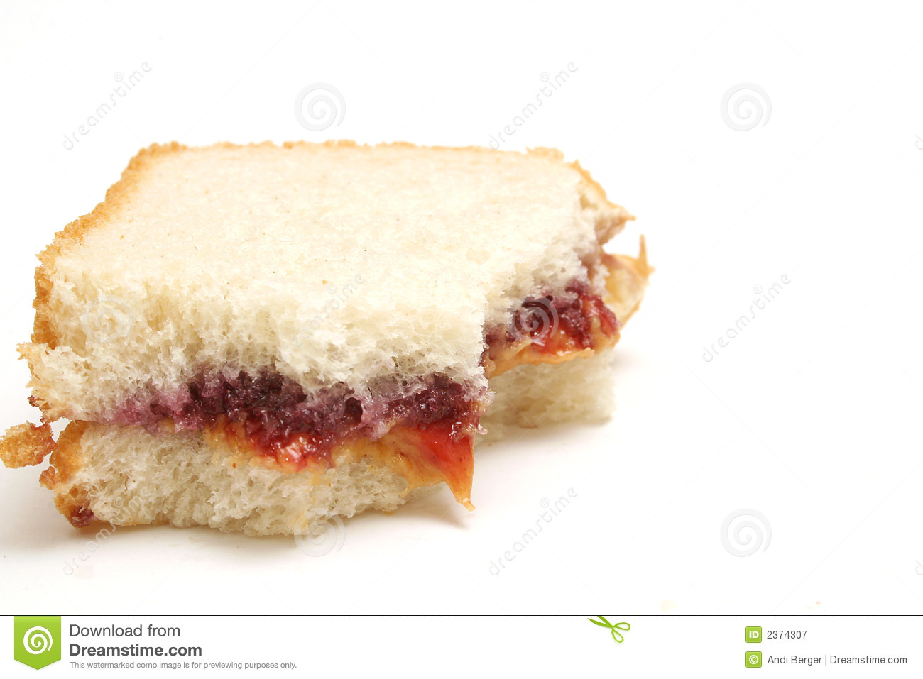 Isolated photo of a peanut butter and jelly sandwich half eaten on white