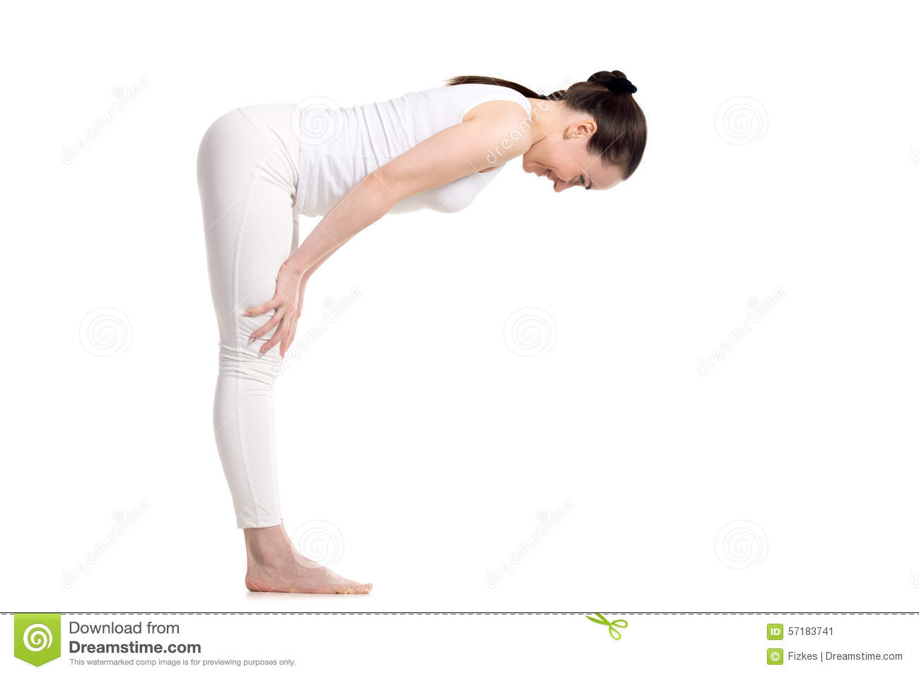Sporty young beautiful smiling beginning yoga female student in white  sportswear doing easy variation of Standing Half Forward Bend, Ardha  Uttanasana pose,