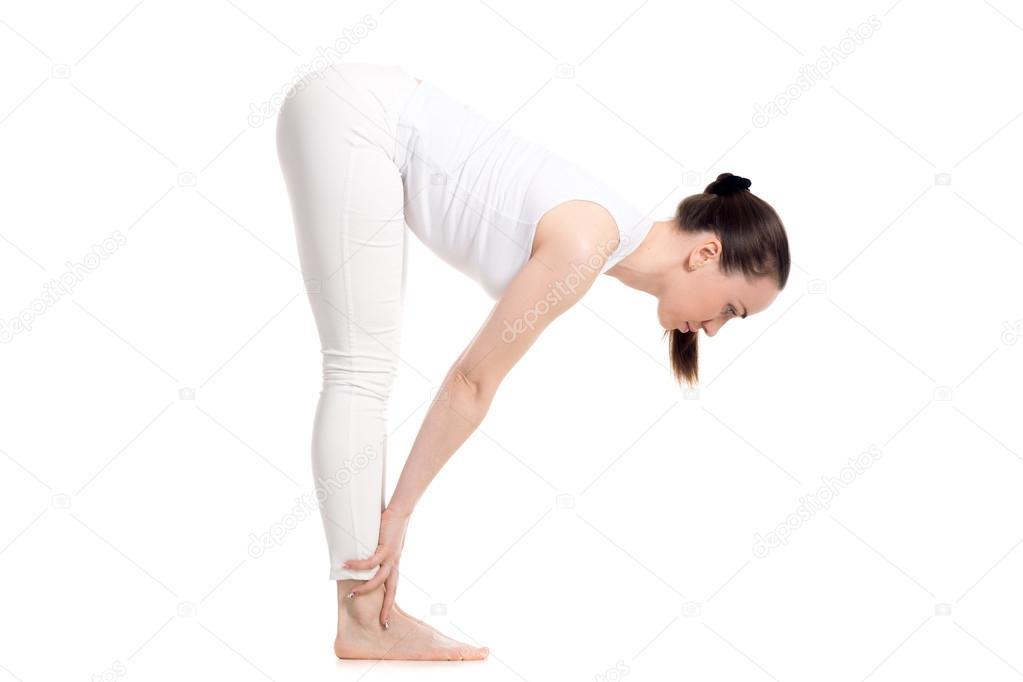 Yogi female standing in Half Forward Bend asana — Foto de Stock