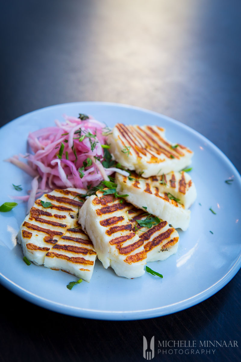 A plate of Grilled Halloumi and coleslaw