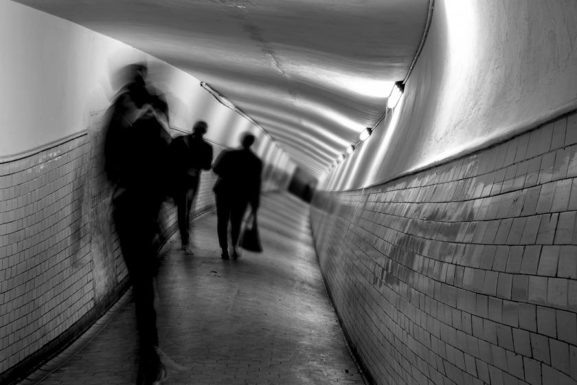 Blurry tunnel with people