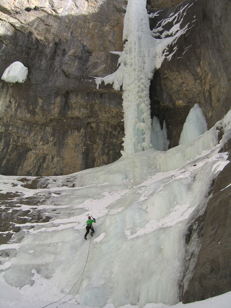 Eric on the ice apron below the pillar.
