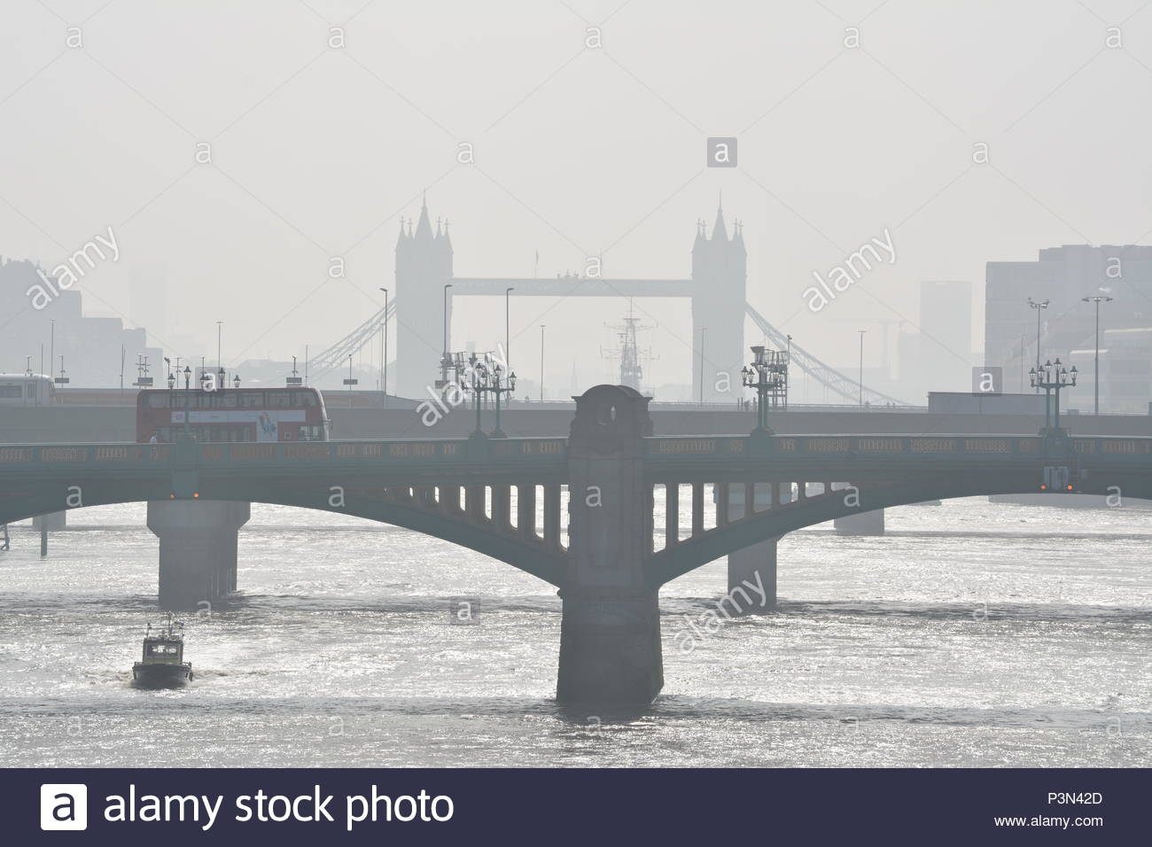 Tower Bridge above the River Thames in London during a iconically foggy  London morning - Stock