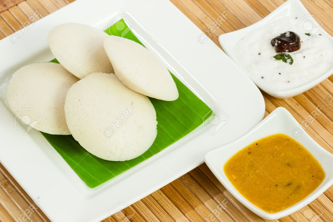 A traditional ethnic south Indian breakfast of Idly Idli rice cake served  with coconut chutney and