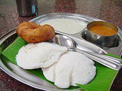 Idli and vada served with separate sambar and chutney