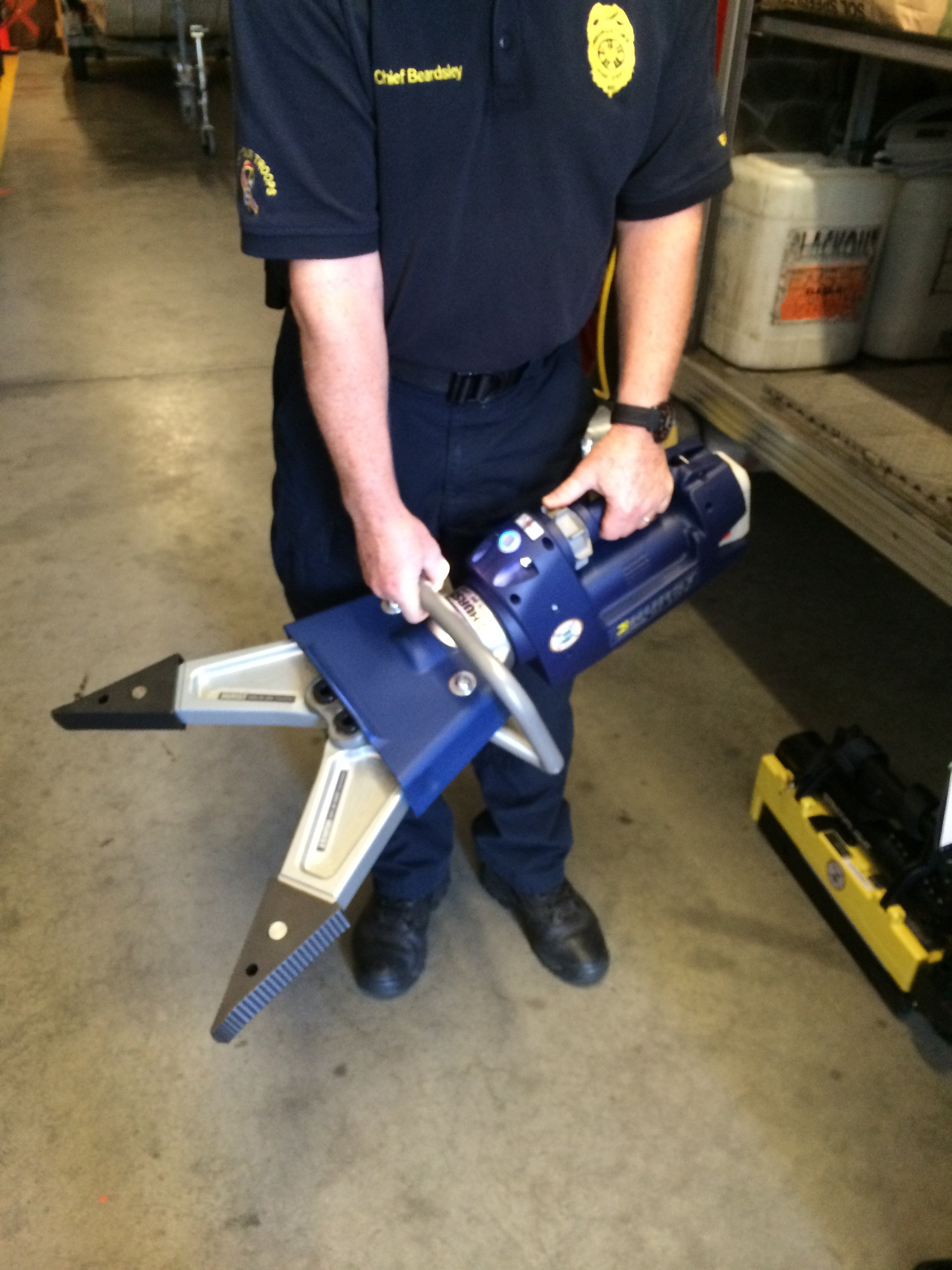 Georgetown Fire Chief Albert Beardsley demonstrates the Jaws of Life  spreader tool (JGPR Photo)